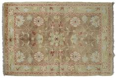 ASYA USHAK / TURKEY Item Number:24758 Width: 4 ft. 0 in. Length: 5 ft. 7 in. Field: ALL OVER PATTERN Field Color: BROWN Border Color: GREEN... (828)-687-1968 www.togarrugs.com