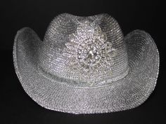 Metallic  silver  straw  Cowgirl  hat  with  a  hand  sewn  rhinestone  starburst  shaped  applique  on  the  crown and  a  silver  glitter  ribbon  hat  band  - $59.95. For  more  info  please  contact - Shoot  for  the  Moon  Jewelry  Designs  (850) 230-9983  #cowgirlhats #westernapparel #strawhats #cowgirls #hats
