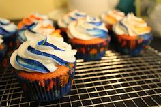New York Mets inpired cupcakes. The unmistakeable blue and orange in cupcake form.