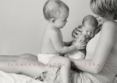 ohhh...this gives me baby fever.  Mother, toddler and newborn photo