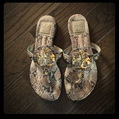 Tory Burch snakeskin sandals These great sandals are super comfy!  They've been worn a handful of times and have very minimal wear on the soles. No scratches on the Tory Burch gold logo.  I typically wear a size 6 and these fit me perfectly. Tory Burch Shoes Sandals
