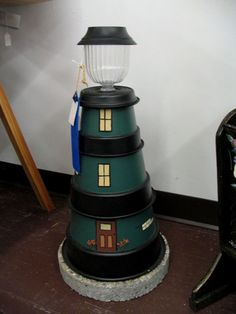 Clay Pot Lighthouse: paint 3 small flower pots, add a small solar lamp to the very top. Clay Pot Projects, Clay Pot Crafts, Diy Clay, Diy Projects To Try, Solar Powered Lights, Solar Lights, Solar Lamp, Outdoor Crafts, Outdoor Projects