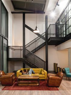 A new steel and wood staircase with mesh balustrades has been inserted into this building, while the metal elements of the interiors are repeated in cantilevered lighting.