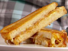 French Onion Grilled Cheese from The Sandwich King on The Food Network. THIS IS AMAZING. You will never see grilled cheese the same way again... Make it (cheat and use pre-made caramelized onions and you can substitute swiss for the gruyere...)