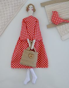 Fabric doll in a bright peachy polkadot dress - modern chic.