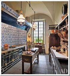 Architectural Digest - Updated kitchen features a La Cornue range, copper cookware decor and antique lantern pendants, in central France. Architectural Digest, La Cornue, Kitchen Tiles, Kitchen Dining, Kitchen Decor, Kitchen Island, Copper Kitchen, Dining Rooms, Narrow Kitchen
