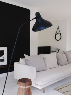 Interior with black wall and beige sofa
