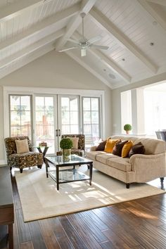 Cottage Living Room with Virginia Mill Works Stone Island Palace Maple Handscraped, French doors, Exposed beam, Ceiling fan