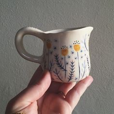 Adorable tiny detailed underglaze work on this ceramic creamer pitcher.