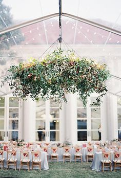 Brides.com: . If your celebration is taking place in a tent, infuse the space with nature by hanging a sprawling greenery chandelier from the center.