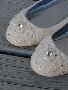 Classy yet dazzling - These shimmery lace flats have been covered in Venitian lace, pearl trim and Swarovski crystals and hand painted with
