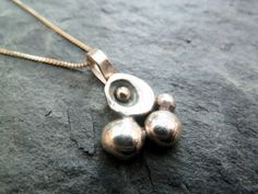 Sterling Silver and 9ct Gold Rock Pool Pendant by TripleMoonStar, £25.00