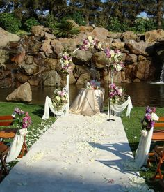 Wedding arch draped with ivory chiffon.   Lavender #roses and #PurpleHydrangea swag brought it to live