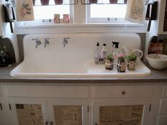 Old+Farmhouse+Kitchens | The old farm sink and check out the doors...the old newspaper...
