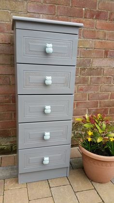 Tal drawers painted in grey with duck egg blue ceramic owl handles
