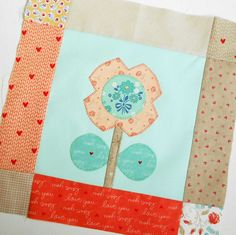 Block 55 - Bloom Block 7. A nice touch of applique from Lori Holt and Riley Blake.
