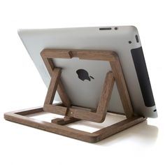 iPad Stand by Oooms. While using the iPad, we noticed it would be very convenient to be able to place the iPad on different angles, without having to hold it. This iPad stand is an adjustable wooden stand which you can use at your desk, in the kitchen, on the couch, etc. It can pop-up into a versatile tablet stand that supports both portrait and landscape viewing modes on 3 different angles. http://www.zocko.com/z/JJoUi