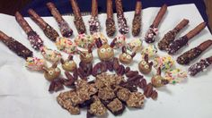 Our actual food we have cooked so far. There are dark Chocolate Covered pretzels rolled in either crushed almonds or crushed pepperment, White Chocolate Covered pretzels with sprinkles, Butter Scotch Reindeer with pecan antlers, Candied Pecans, Toasted Almond Butter Chocolate Toffee.