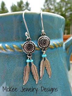 Feather charms and sterling silver earrings.