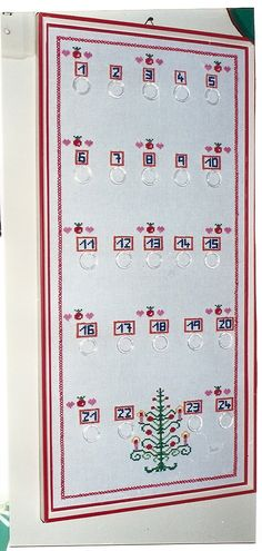 calendário de advento bordado em ponto cruz
