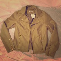 Calvin Klein Jacket Beautiful sandy/tan colored Calvin Klein leather zip up jacket with gold detailing. Brand new with tags! Size: M Calvin Klein Jackets & Coats