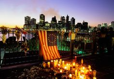 """""""We Are All Americans"""" In the aftermath of the 9/11 attacks, people all over the world stood shoulder-to-shoulder in mourning, solidarity, sympathy and friendship with the people of the United States. Here are a few of those international reactions, both organized and spontaneous, that occurred in the days following September 11, 2001."""