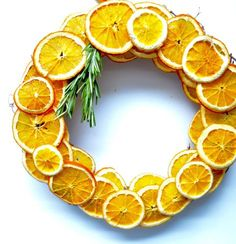 After you complete the surprisingly simple process of drying your orange slices, use rosemary as a fragrant accent for this dried citrus wreath.