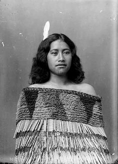 NEW ZEALAND Harimate, a young Maori woman probably from the Whanganui region. She wears a fine cloak, white feather headdress and the moko kauae, or woman's chin tattoo. Photo by Frank J. Denton
