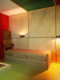 The bed with under storage in Le Corbusier's Petit Cabanon.. A reproduced cabanon was shown @ a Design Miami showroom this year.