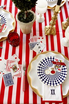 Table with playing cards, striped tablecloth