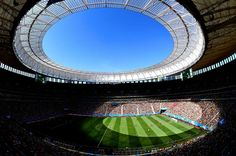 Portugal vs. Ghana under a bright blue Brazilian sky at Estadio Nacional in the two teams' final group stage match.