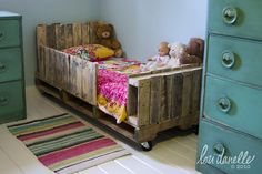 Toddler Pallet bed by Lori Danelle, via Flickr -- I would have sanded and stained the pallets. But it's sort of a neat idea.