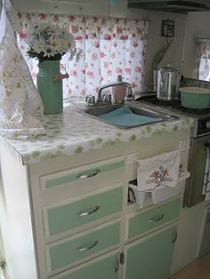 nora pearl's vintage camper.  I love the mint green cabinets and the muted colors in this one.  Very pretty.
