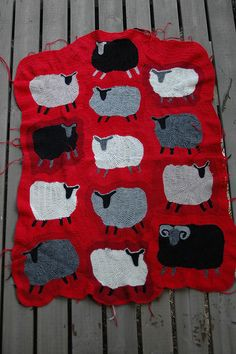 I'd make this as a soft blanket with appliqued knitted/felted sheep on it, I think.
