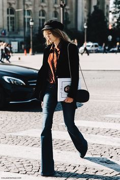 Hat, blazer, flare jeans, and mini bag.