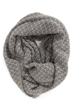A plush knit creates the decadent feel and warmth of this diamond-stitched infinity scarf in grey.