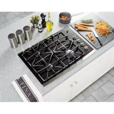 GE - 30 Inch Built-In Gas-On-Glass Cooktop, Stainless Steel - JGP940SEKSS - JGP940SEKSS - Home Depot Canada