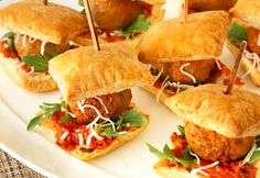 When is a meatball appetizer so much more?  When it's a BITE-SIZE MINI MEATBALL SUB!  So EASY .... So CUTE ... and SO TASTY!  Great for your wedding reception, rehearsal nibbles .. or ANYTIME!  Secret is puff pastry and easy ingredients -- GOTTA TRY THESE!