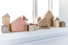 wooden house blocks from recycled timber that were salvaged from destroyed homes | Rekindled