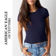 SALE AEO | Navy Blue Polka Dot Baby T Shirt Brand: American Eagle Outfitters Size: Large  This shirt is in good condition. It is navy blue and features black polka dots throughout. It is short-sleeved and slightly cropped with short slits on the sides.  Two are available, both in the same condition. American Eagle Outfitters Tops Tees - Short Sleeve