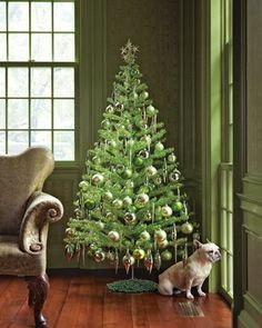 Evergreen Tree:   This light green tree, shown in the green room of Martha's Bedford, New York, home, is not vintage but is several years old. It's decorated with silver and green ornaments and a tree topper made from tinsel stars. The base is covered with a coil of beaded garland.