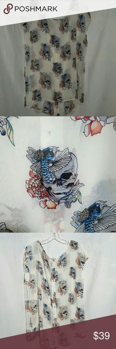 🍒NWOT CHELSEA & VIOLET SKULL BLOUSE ❤NWOT❤ skull sheer off white blouse,   colors are very vibrant.  Button closure down the back.  100% polyester..  Please ask any and all questions before purchasing this item Chelsea & Violet Tops Blouses