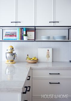 This white kitchen has hits of black and subtle graphic accents for a clean and . This white kitchen has hits of black and subtle graphic accents for a clean and modern look. Kitchen Remodel, Kitchen Design, White Modern Kitchen, Kitchen Decor, New Kitchen, Kitchen Interior, White Kitchen, Kitchen Style, Kitchen Cabinets