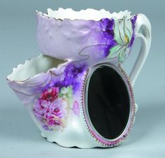 """RS Prussia Scuttle Shaving Cup with oval mirror, 3"""" d. x4"""" h. Iris mold with pink poppies on purple to pink background and gold highlights throughout."""