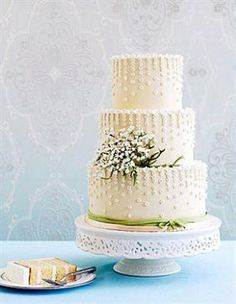 lilies of the valley cake - This elegant design by Kate Sullivan of Cake Power features vanilla cake tiers that are covered in ivory fondant and decorated with hundreds of tiny lily-of-the-valley buds. Elegant Wedding Cakes, Beautiful Wedding Cakes, Gorgeous Cakes, Pretty Cakes, Amazing Cakes, Bolo Cake, Spring Cake, White Cakes, Wedding Desserts
