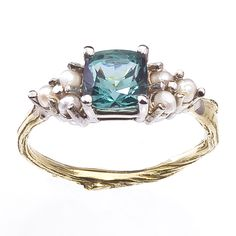 Barbara Michelle Jacobs Jewelry. A gemstone in a mermaid-like hue and a setting cast from an actual twig found in Central Park add up to an enchantingly unconventional engagement ring. 18k gold ring with blue-green tourmaline center stone and seed pearls, $1,480, Barbara Michelle Jacobs Jewelry