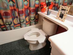 Universal Design WINGMAN toilet seat serving all guests regardless of their ability level in the guest bathroom