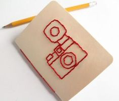 DIY Embroidered Camera Notebook Tutorial and Template from Lula Louise here.I took book binding classes, but my time is limited and I'd probably buy the notebooks and figure out how to add the embroidery. *This would make such a cute gift.