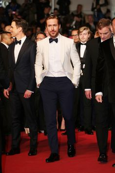 Ryan Gosling wore a Gucci custom white shawl lapel one button Signoria evening jacket with white dress shirt, midnight blue evening trousers, satin bowtie and black patent leather lace ups to the ''The Nice Guys'' premiere during the Cannes Film Festival. Groom Tuxedo, Tuxedo For Men, Groom And Groomsmen, Tuxedo Suit, Ryan Gosling, Wedding Men, Wedding Suits, Wedding Attire, Wedding Tuxedos