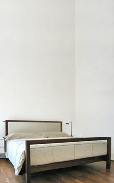 SIMPLE II BED  SHOWN IN American Black Walnut with Hand Rubbed Dark Oil Finish  DESCRIPTION Upholstered headboard, slat bed. Ash and leather...
